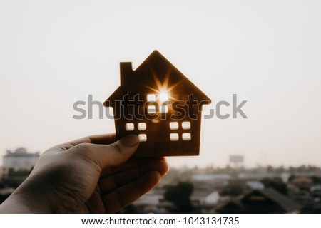 House model in home insurance broker agent 's hand or in salesman person. Real estate agent offer house, property insurance and security, affordable housing concepts