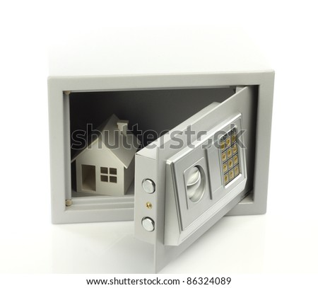 House model in safe box. Real property or insurance concept