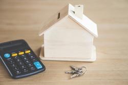 house model keys and calculator on desk ,