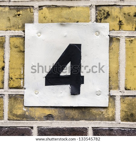 House number four, black lettering on a white plate