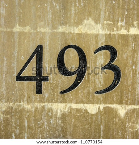 house number four hundred and ninety-three engraved in a brass plate - stock photo