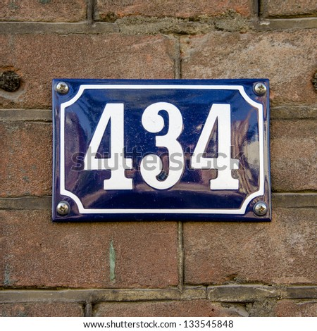 house number four hundred and thirty four. White lettering on a blue enameled plate.