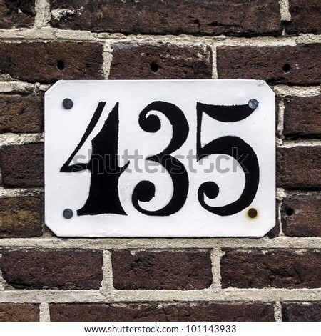 house number four hundred thirty-five on a brick wall
