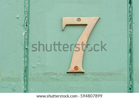House number 7 sign on green painted door #594807899