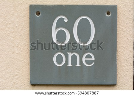 House number 61 sign on wall #594807887