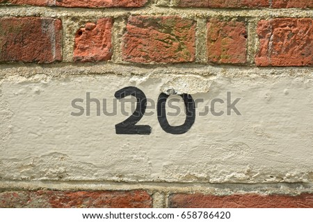 House number 20 sign painted on wall #658786420