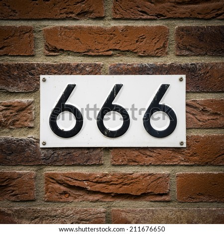 house number six hundred and sixty six embossed in a metal plate.  The number of the beast.