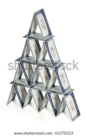House of cards made out of social security cards isolated over white background