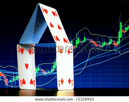 House of cards with a stock graph in the background represent mortgage themes...