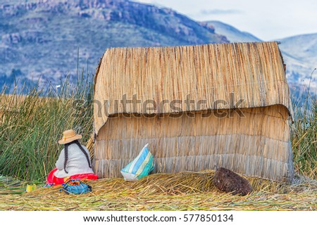 House of local people on floating Uros island, Lake titicaca, Peru #577850134