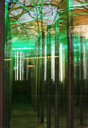 house of mirrors, glass maze on an amusement funfair, abstract concept for finding the way out