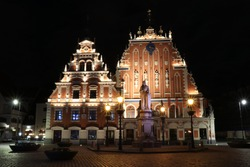 House of the Black Heads lit up at night in the town square of Riga Old Town, Latvia