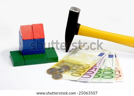 House of wooden bricks, euro notes and a hammer on bright background