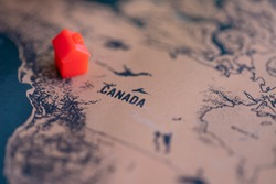 House on Canada part of world map. Selective focus. Real estate in Canada concept.