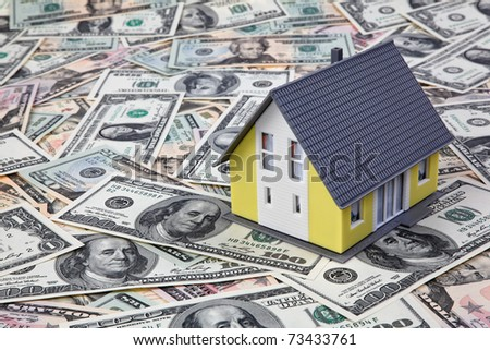House on dollar bills. Housing crisis in America.