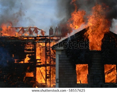 house on fires with flames shooting out