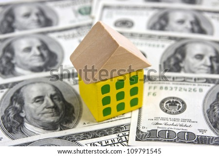 House on hundred dollar bills - USA real estate concept