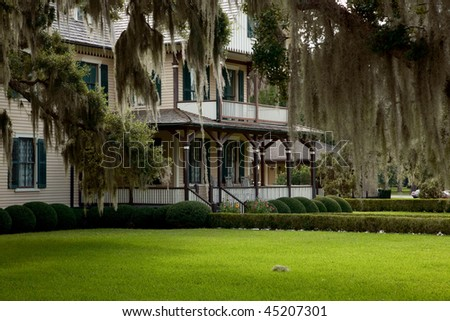 House on Jekyll Island, Ga, with spanish moss and a yard