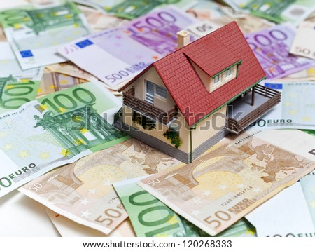 House over Euro banknotes background
