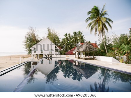 house over the beach with infinity pool and seaview. tone image. #498203368