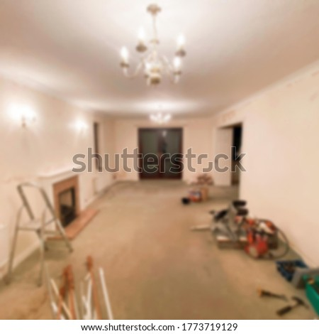 house paint equipment scattered in the room blur . blurred background