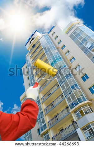 house painter on blue sky background