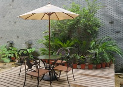 House patio with  table and chairs under umbrella