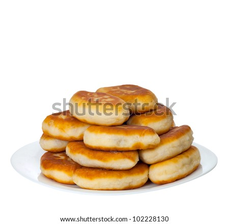 House pies on a plate on a white background
