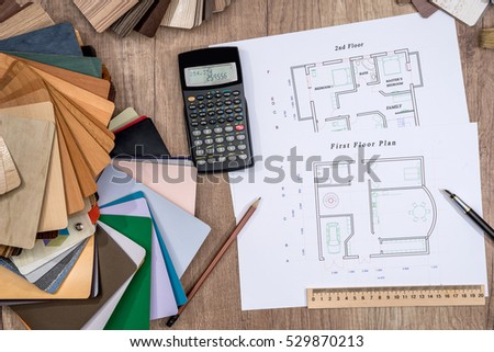 house plan with a choice of wooden on desk.