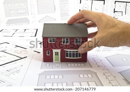 House plans, house & hand