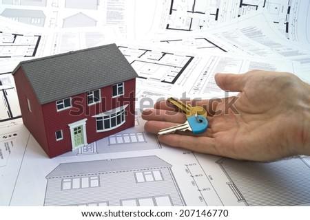 House plans, house, hand & keys