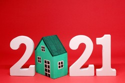 House Property trends 2021 , 2021 number wooden with House model on red background - home new year - red concept of Real Estate, Property for Sale and rent