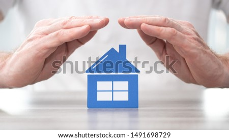 House protected by hands - Concept of home insurance #1491698729