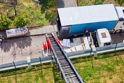 House removal with a hydraulic ladder truck. Aerial view from above.