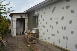 House renovation and polystyrene insulation. External wall insulation with styrofoam, polystyrene, EPS, plastering and home addition.