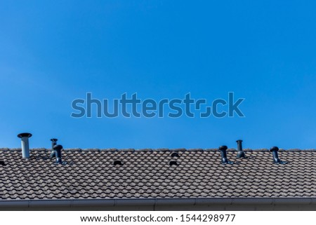 House roof with many fireplaces of gas heating #1544298977