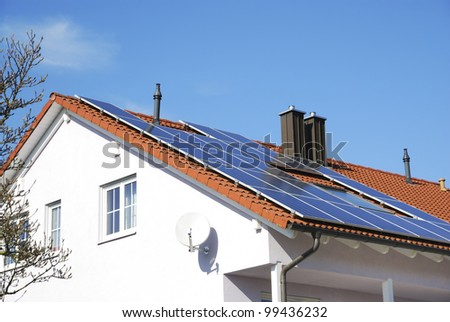 House roof with photovoltaics installation