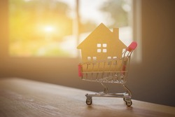 house shape inside of the shopping cart ,How to become a first time homeowner,Concepts about online shopping that consumers can buy things directly from their home or office just using web browser