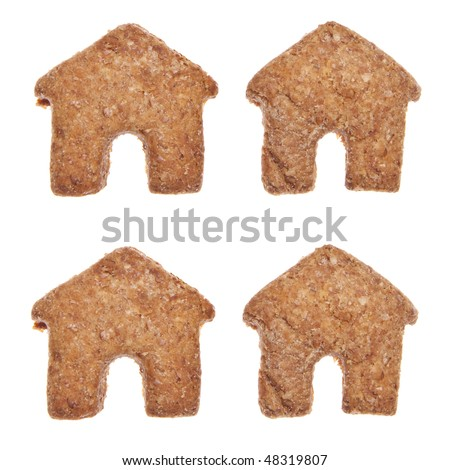 House shaped cookies or pet treats for your cat or dog.  Isolated on white with a clipping path.