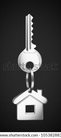 House shaped keychain on black background