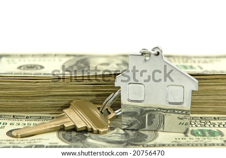 house shaped keychain with money isolated against white background