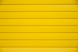 House siding. Yellow plastic panel siding texture.