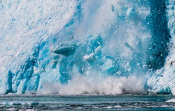 House-sized blocks of ice come crashing down into Prince William Sound in Alaska as pieces of the Harding Icefield flow down this glacier and break away.
