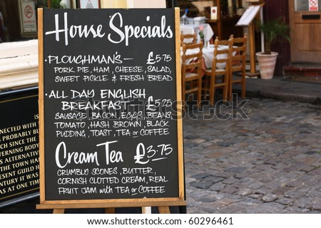 House Special menu board with a street cafe or restaurant in the background - stock photo