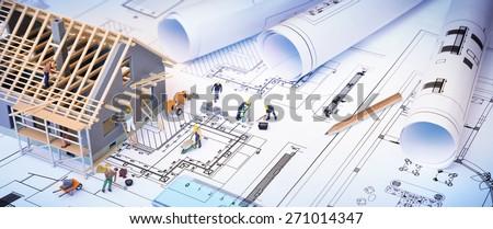 house under construction on blueprints - building project