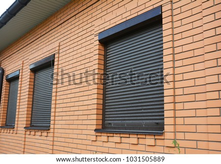 House Windows with rolling shutters for home protection.