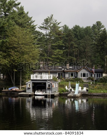 House with boathouse on a river