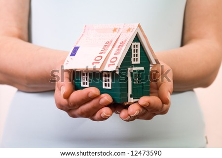 House with euro banknotes roof- home insurance concept