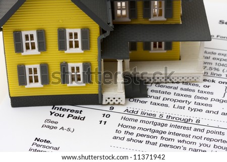 House with money and tax paper – us schedule A form