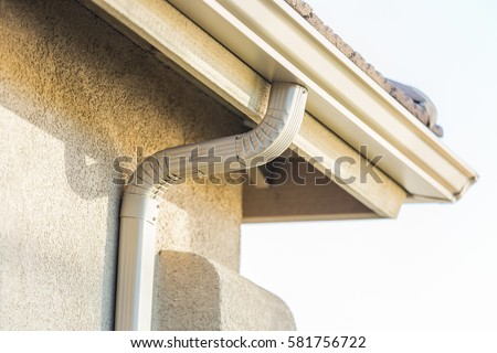 House with New Seamless Aluminum Rain Gutters.